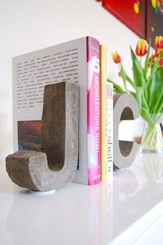 DIY Concrete Letter Bookends My love affair with all things concrete goes back a long way. I started my first concrete experiments about 12 . Concrete Crafts, Concrete Garden, Concrete Projects, Concrete Design, Stamped Concrete, Polished Concrete, Beton Diy, Concrete Furniture, Ideias Diy