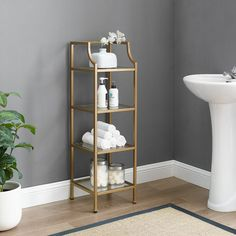The stylish and modern design of the Crosley Aimee Short Etagere makes it perfect for updating your bathroom or home office. This piece features a sleek yet sturdy steel frame, and its tempered glass shelves offer ample storage space. Metal Bookcase, Etagere Bookcase, Metal Shelves, Shelving, Gold Etagere, Gold Bad, Gold Bathroom, Bathroom Ideas, Master Bathroom