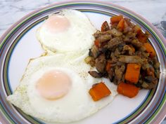 duck hash with fried eggs (paleo, with mushroom, sweet potato, duck, shallots and garlic)
