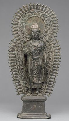 Standing Buddha with radiate combined halo, ca. late 6th century  Pakistan, ancient region of Gandhara  Brass