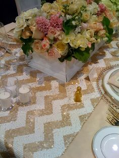 Love this gold chevron table runner! http://www.prettymyparty.com/all-about-chevron/