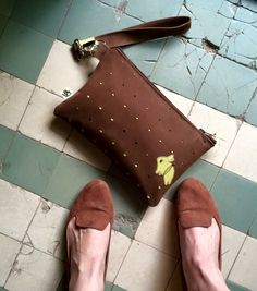 brown leather clutch with lime rabbit