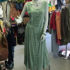 """Bohemian chic romantic India dress size M Beautiful green long cotton dress with a button down front and tie in the back. If your a hippie chick like me you know all about these. Made in India, this is 60% cotton, 40% rayon in a size M. Total length from shoulder to bottom hem is 51"""" approx. Dresses Maxi"""