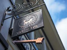 The store sign at the entrance points to the entrance of Shop the Fox, the newest expansion of the Foxy brand. - Josh Galemore/Savannah Morning News