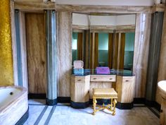 Eltham Palace. Bathroom- Virginia Courtauld's bathroom, one of many original interiors to survive from the 1930s. The walls are lined with onyx, with gold mosaic tiles in the bath niche