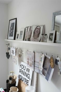 Use IKEA photo ledge, curtain wire and clips to display hang your favorite… Photos Encadrées, Picture Hangers, Ikea Picture Shelves, Photo Shelf, Ikea Shelves, Picture Wire Hanging, Ikea Photo Ledge, Shelves Above Desk, Shelving
