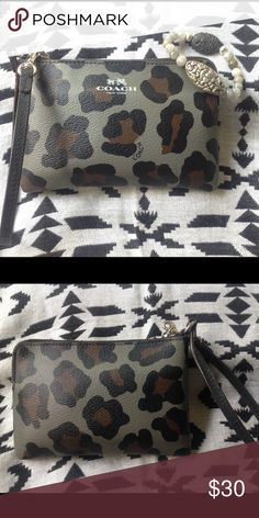 Authentic COACH Leopard print Wristlet! Purchased from another Posher months ago and I just haven't used it. Excellent condition! NWOT! Coach Bags Clutches & Wristlets
