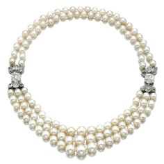 Natural Saltwater Pearl and Diamond Necklace. Set at the front with three rows of pearls graduated in size, embellished to each side with a circular-cut diamond bordered by stylised leaves set with similar and cushion-shaped stones, continuing to the back with two rows of pearls.
