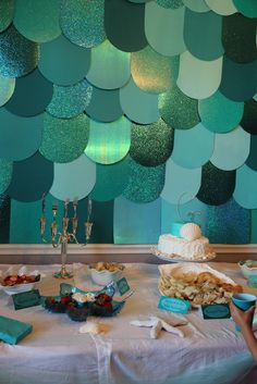 Scrapbook paper backdrop at a Pirates and Mermaids Birthday Party!  See more party ideas at CatchMyParty.com!
