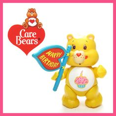 "This vintage Care Bears PVC miniature figurine is ""Wish Bear Making Wishes Come True."" Wish Bear is aqua blue with a yellow shooting star on her tummy and is holding a yellow genie lamp. Her eyes are"