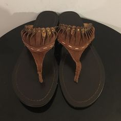 """Nine West Studded Brown Suede Thong Sandals Up for grabs is this pair of sandals from Nine West. They are a size 8.5M and are a thong style sandal. These sandals are brown suede with a 3D twist detail accented with bronze tone rivets. The heel has a slight elevation with a 0.5"""" block heel. These sandals have been gently worn and are in terrific condition. Nine West Shoes Sandals"""