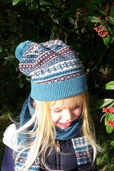 0e4c28a5cb573 Fair isle adult ski hat with matching scarf and ladies gauntlet wristlet  gloves in teal colourway. The Croft House