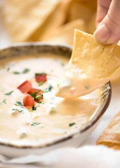 Code cracked: made with real cheese, this Queso Dip is a copycat of the cheese dip sold in jars and served at your favourite Mexican restaurant. The miracle of this is that it's silky smooth even with Queso Dip Mexican, Cheese Dip Mexican, Queso Cheese, Cheese Dips, Mexican Corn, Cheese Enchiladas, Cheese Toast, Cheddar Cheese, Sauces