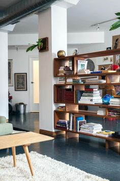 This shelf also acts as a divider to help delineate space in this open concept home.