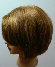 Blowdrying technique-flat stacked in the back.  Volume on top.