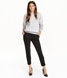 Black. Treggings in thick jersey with an elasticized waistband, mock fly, side pockets, and welt back pockets.