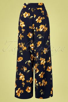 0d9c0b48a48 Get in a tropical state of mind with these 70s Emila Floral Palazzo Pants  in Navy! The feminine high waist contrasts beautifully with the wide legs  and is ...