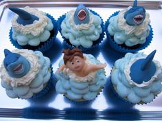 love the shark ones. i find the alarmed boy cupcake disturbing, though!