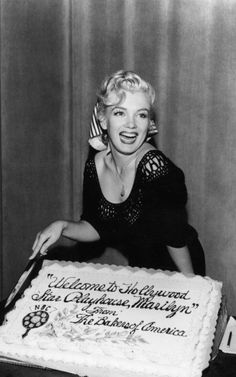 Marilyn with a cake given to her by the sponsor Bakers of America, during her radio debut on the Hollywood Star Playhouse for NBC radio, August 21st 1952.