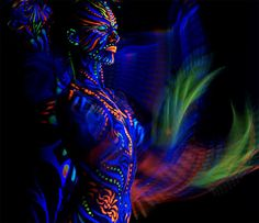Neon body paint;; Very vibrant and exciting, great work.