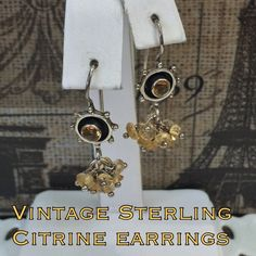 """Vintage Sterling Silver Citrine Dangle Earrings This is a very unique pair of vintage Sterling silver citrine drop earrings with 11 dangle stones/ beads. Marked 925 INDIA w/ makers mark. Measures 1.25"""" long X 0.25"""" wide. These earrings are in great vintage condition! Dress them up or down! Please don't hesitate to ask any questions. Thanks for stopping by my closet! I ship out same day as purchase. Buy with confidence, over 190 5 star feedback! Please make REASONABLE offer using the offer…"""