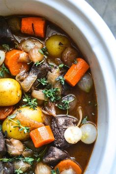Slow Cooker Beef Bourguignon has crazy tender melt in your mouth beef and hearty veggies slow cooked to perfection in a rich sauce.