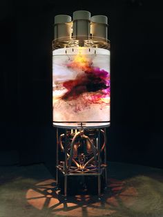 Colored inks slowly flow in a clear water tank. Photography by Andre Morin.