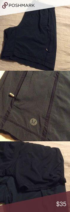 Lululemon Men's Workout Shorts Black workout short with stretch lining, mesh panels and front zippered  pockets, lululemon athletica Shorts Athletic