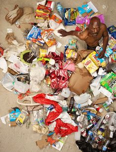 'People Lying in a Week's Worth of their Trash' by Gregg Segal: The average American in 2014 produces of garbage per day per person. That is twice the personal garbage production rate of Americans in People Lie, Photographs Of People, Expositions, Environmental Issues, Environmental Pollution, Greggs, Photo Projects, Bored Panda, Madame