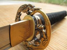 Ronin Katana hammer forged samurai sword #7 (one of a kind) with gunome hamon, folded 1095 steel, dragon theme, and ray skin saya. Forged in June of 2013