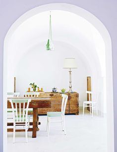 Coastal style dining / living room. Rustic wood furniture with mint green and statement lihting. More stylish decorating ideas at www.redonline.co.uk