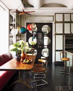 1950's light fixture, ebonized oak floor, leather-and-chrome chairs...makes me smile