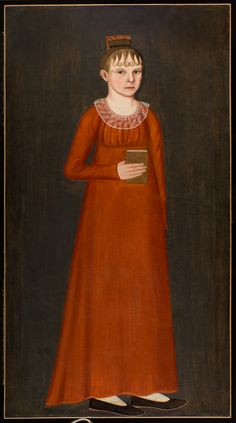 """This portrait of young Lucy Wheeler, of Stonington, Connecticut, is a dramatic image created by the brilliant orange dress against the stark brown background. 55 x 29 1/2 inches Circa: Cirac 1810 Attributed to John Brewster, Jr. Medium: Oil on canvas in a reproduction frame Miscellaneous: Provenance: Descended in the family of the sitter; Sotheby's, NYC, January 1986; Private Vermont collector. Exhibited: New London, CT, The Lyman-Allyn Museum, """"Eighty Eminent Painters of Connecticut"""", 1947."""