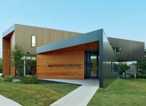 At $176/sqft, the architects deliver a small but powerful school in a tight site.  Fayetteville Montessori Elementary School, Marlon Blackwell Architect, Fayettevill, Arkansas.