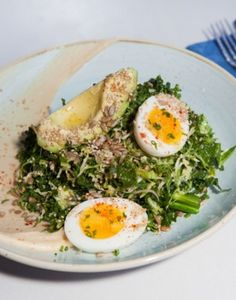 Two Hands Restaurant & Bar Opens in Tribeca -- Brassicas bowl with charred broccolini, Brussels sprouts, kale, hummus, soft-boiled egg, avocado, pickled shallots, and seeds.