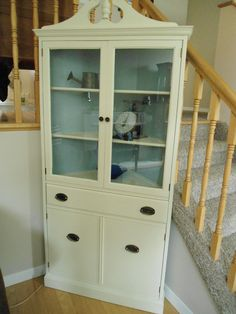 corner hutch in old white and duck egg blue. Great for a condo.