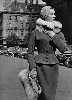 Rose Marie in jersey suit by Jacques Fath, photo by Pottier, 1954