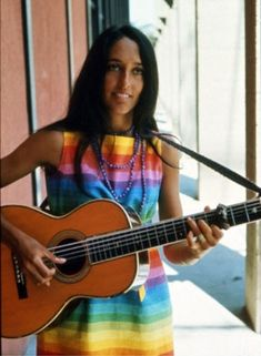 Joan Baez in a rainbow dress
