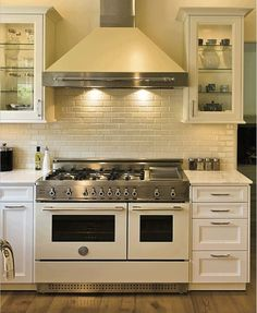Love the tiles behind the shove and the stove itself!