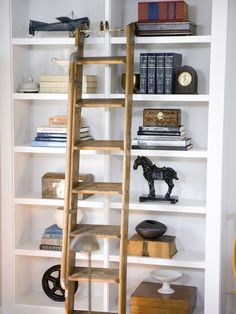 Transform bland bookcases and wall shelves into stunning displays with 18 top-shelf decorating tips from interior designers. Display Shelves, Wall Shelves, Shelving, Book Shelves, Ladder Bookshelf, Wood Ladder, Decorating Bookshelves, Bookshelf Styling, My Living Room