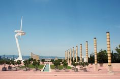 Completed in 1992 and built to broadcast coverage of that year's Olympic Games in Barcelona, the Montjuïc Communications Tower also acts as a large sundial. The white-metal-plated tower was inspired by a depiction of an ancient Greek athlete kneeling to collect his medal.