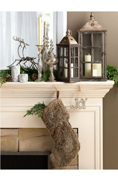 Family Gathering: Decorating the Mantle - love the lanterns, the greenery, the silver decor, and the woodsy/furry stocking!!!