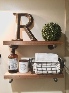 Industrial pipe shelves. My DIY project for my restroom . Shelves  decor . Bathroom decor. Over the toilet storage ideas.