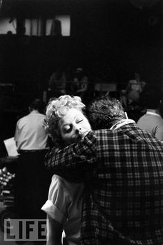 Desi Arnaz embraces Lucille Ball at the new home of their TV production empire, Desilu Studios, in 1958.  Photo: Leonard McCombe/TIME & LIFE Pictures