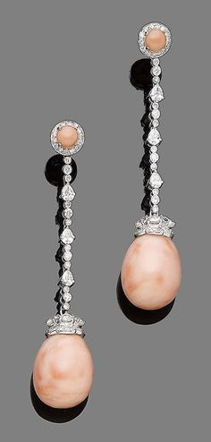 A pair of coral and diamond pendent earrings Each coral corallium rubrum drop, capped to the front by rose-cut pear-shaped and brilliant-cut diamonds, suspended from a line of pear-shaped and brilliant-cut diamonds, to a cabochon coral and single-cut diamond cluster, pear, brilliant and single-cut diamonds approx. 1.75cts total, length 6.5cm