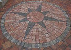 Stone compass idea for patio.