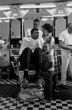 Chicago, Illinois. 1966. Muhammad Ali gets his hair cut at a barbershop in Southside Chicago