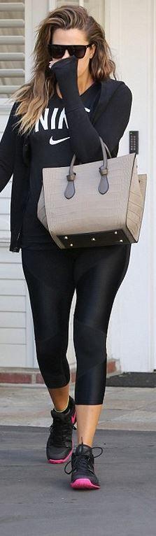 Khloe Kardashian: Shirt and shoes – Nike  Sunglasses – Saint Laurent  Purse – Celine