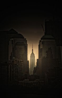 The Empire State Building, New York City. Photo by Dennis Herzog. Who sees the face on the building on the left?