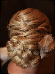 See more Wedding hair styles with flower for ladies
